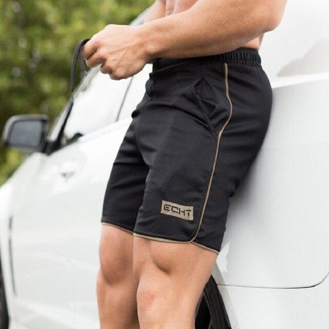 גברים של חדר כושר כושר מכנסיים פיתוח גוף ריצה אימון זכר קצר מכנסיים ספורט ריצה לנשימה מהיר ייבוש רשת מכנסי טרנינג