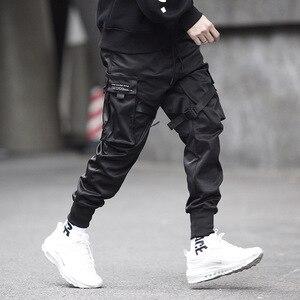 Image 2 - Hip Hop Black Pencil Pants Men Cargo Pants Streetwear Men Pockets Harem Joggers 2019 Spring Fashion Mens Pant Ribbon HD070