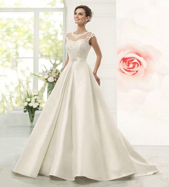 beda4b58deb New Appliques Satin Ball Gown Wedding Dresses with Illusion Neckline Cap  Sleeve Bridal Dress Vestidos De Noiva Tulle