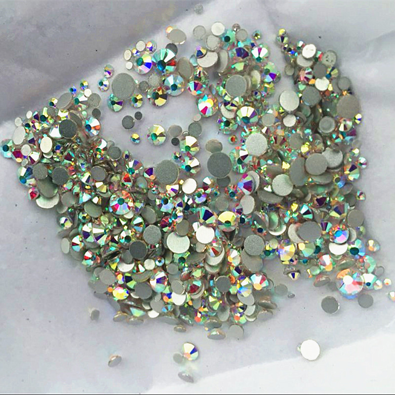 Høy kvalitet 1000PCS Mix Størrelser Crystal Clear AB Non Hotfix Flatback Nail Rhinestones For Nails 3D Nail Art Decoration Gems