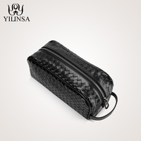 The first layer of leather woven bag hand bag man bag leather wrist bag male leather large tide clutch