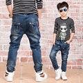 Новый Год, детские джинсы весна и осень брюки узкие брюки мальчиков случайные вс-спички эластичные джинсы детская одежда