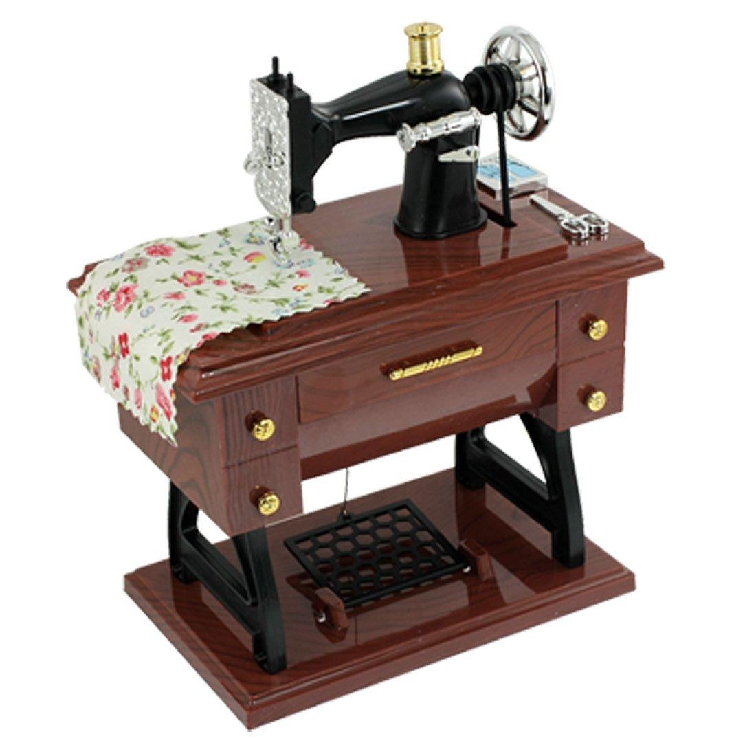 Como vento acima do vintage mini máquina de costura estilo caixa de música mecânica
