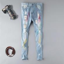 Modne niebieskie haftowany kwiat projektant zamek mycia dżinsy mężczyzn wysokiej jakości spodnie jeansowe w trudnej sytuacji marki proste spodnie