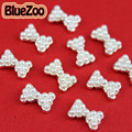 BlueZoo 10 unidades/pacote Branco 3D Liga Faux Pérola Pedrinhas Bow Tie Nail Art Decoração Para Acrílico Dicas de Beleza Frete Grátis