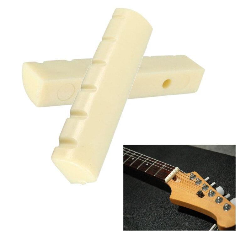 1 unids 43mm Guitarra Puente de Silla Tuerca Diestro Guitarra Accesorios Para Instrumentos Musicales de la Guitarra Acústica Tuerca Tuerca De Plástico Eléctrica