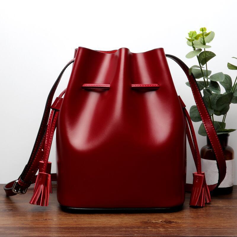 High Qualit new small bucket cowhide lady composite bag shoulder bag mini handbags tassel bags crossbody Female bags handbags-in Top-Handle Bags from Luggage & Bags    1