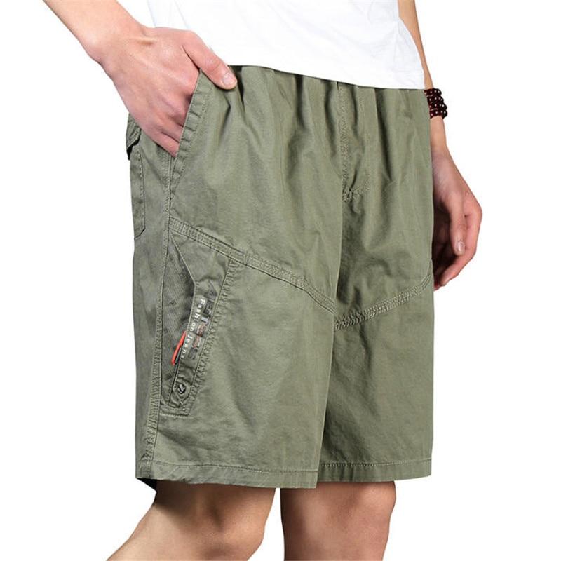 Pantalones cortos para hombres Verano Tallas grandes de algodón Cintura elástica Suelta Pantalones cortos de carga verde para hombre para hombre Pantalones cortos ocasionales A3369