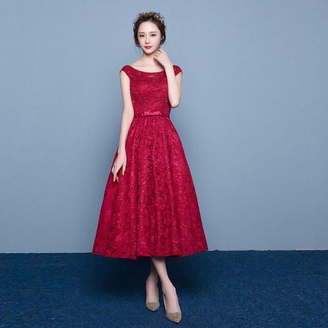 women tea length, red dress, cap sleeved