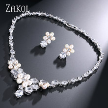 ZAKOL Exquisite Imitation Pearl Flower Connected Top Quality Cubic Zirconia Jewelry Sets for Wedding FSSP047(China)