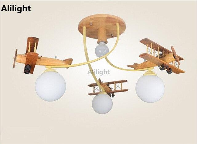 trendy moderne avion led plafonnier enfants chambre plafond lampe de protection des yeux en bois. Black Bedroom Furniture Sets. Home Design Ideas