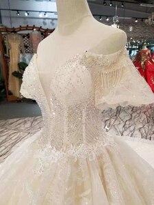 Image 5 - LSS206 샴페인 레이스 웨딩 드레스 2020 짧은 플레어 슬리브 섹시한 v 백 웨딩 드레스 우아한 11.11 글로브 쇼핑 축제