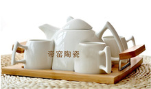 2017 High-grade white porcelain tea sets with bamboo tray creative ceramic tea wholesale Kung Fu tea sets