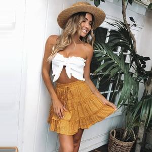 Image 5 - Lossky חצאית נשים פרחוני הדפסה לפרוע שרוכים Pleate מיני חצאית Boho צ י גבוהה מותן קצר קיץ חוף עץ אוזן חצאית נקבה