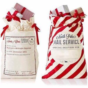 Image 1 - 50pcs/lot Large Santa Sacks Drawstring Christmas Sacks 38 Styles Christmas Canvas Sack Kids Gift Bag Candy Cane Bag Wholesale