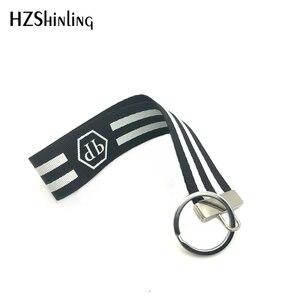Новое модное поступление брелоков для ключей в черно-белую полоску, Брелоки для ключей, автомобильные сумки, ручная работа, брелок для ключей с орнаментом