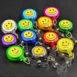 Image 2 - 30pcs/lot Smiling Face Retractable Pull Key ID Card Clip ID Badge Lanyard Name Tag Card Holder School Office Company Papelaria