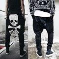 Punk rock skull ghost hombre harén pantalones elásticos de la cintura baja pantalones bolsillos ocasionales flojas pantalones caídos