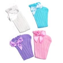 цена 2016 solid bow knee high girls boot socks infant socks leg warmer toddler baby socks knee pads for children meias baby accessory в интернет-магазинах