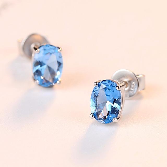 CZCITY Topaz Earrings 1.8 Carat Oval Sky Blue Topaz Birthstone 925 Sterling Silver Stud Earring for Women Gemstone Jewelry