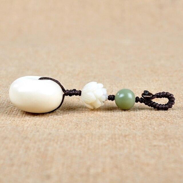 Coche creativo Natural Marfil bun anillo clave hebilla colgante seguridad Bodhi lotus lotus regalos masculinos y femeninos