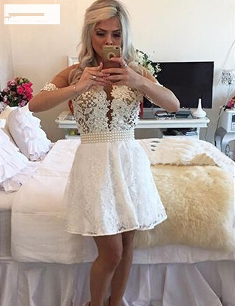 11e6f8e4e87 Short White Homecoming Dresses Pearls Beaded Lace Homecoming Dress 2016  Sheer Backless Mini Prom Gowns Graduation Dresses HC22-in Homecoming Dresses  from ...