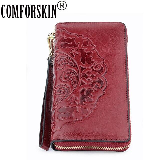 COMFORSKIN uzun Vintage püskül bayan cüzdan Premium hakiki deri benzersiz kabartma çiçek kadın fermuarlı çantalar el halat ile
