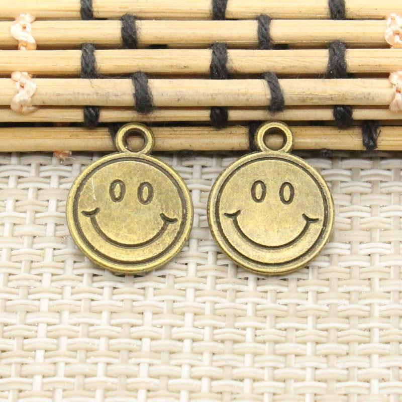 1d881e263bcc Amuletos cara sonriente 50 unids 12mm no. gt02506 tibetano bronce DIY retro joyas  pulsera collar pendiente de bronce antiguo