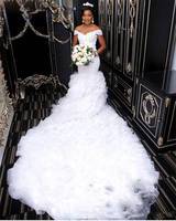 2018 Mermaid Wedding Dresses African Off Shoulder Tiered Ruffles Lace Appliques Beaded Crystal Zipper Chapel Train Bridal Gowns
