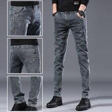 45ac2b75b60 Хо Новый 2019 Мужская мода молодежи эластичные джинсы серый контракт джокер  маленькие ковбойские штаны
