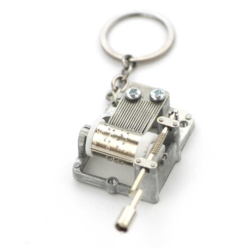 купить Keychain Hogwarts Game of Thrones DIY Music Box Keychain Music Movement Set 18 Tones Beautiful Melody Brinquedos For Men Women по цене 134.9 рублей