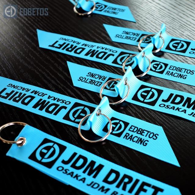 5 pzas/lote EDBETOS carreras clave para Osaka Jdm RACING Kanjo deporte de Motor llaveros de Color verde azulado ropa cremallera teléfono móvil cordones