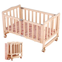 Environmental New Zealand Pine Solid Wood Paint free Folding Portable Baby Wood Crib Bed Rocking Infant Cradle Crib with Roller