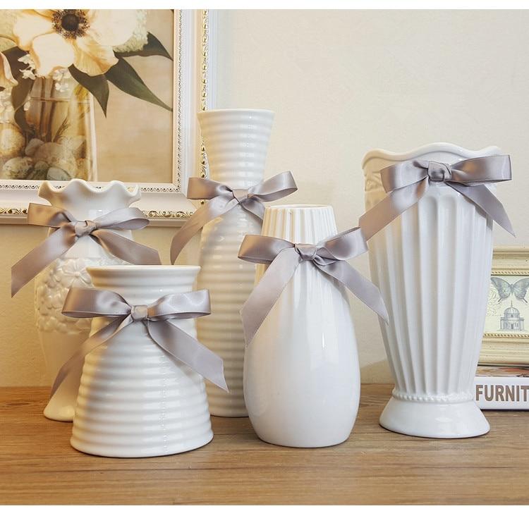 Šiuolaikinės mados baltos keramikos gėlių vazos namo apdaila stalviršio vaza Europoje stiliaus balta keramikos vaza vestuvių deco kramtinė vaza