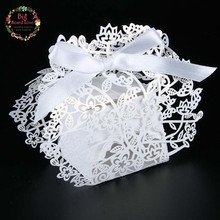 2016 New 50pcs/lots Laser cut flower wedding favor box candy box wedding favor and gifts party gift box wedding supplies(China (Mainland))