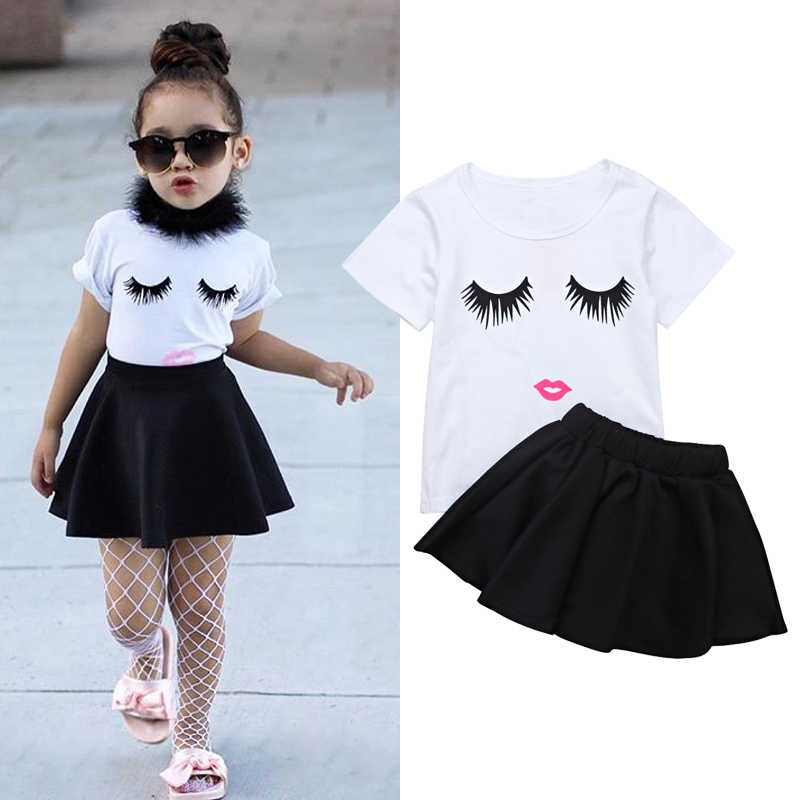 3877b7dd1 2018 Summer Little Girls Clothes New Fashion Eyebrows Pattern Suit White  Short Sleeve Tops+Black