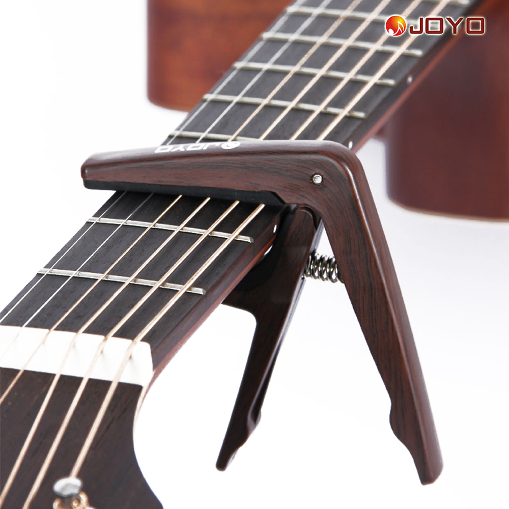Joyo Plastic Guitar Capo Strong Spring Opener Capo Clamp On Neck For Acoustic Electric Guitar JCP-01 amumu traditional weaving patterns cotton guitar strap for classical acoustic folk guitar guitar belt s113