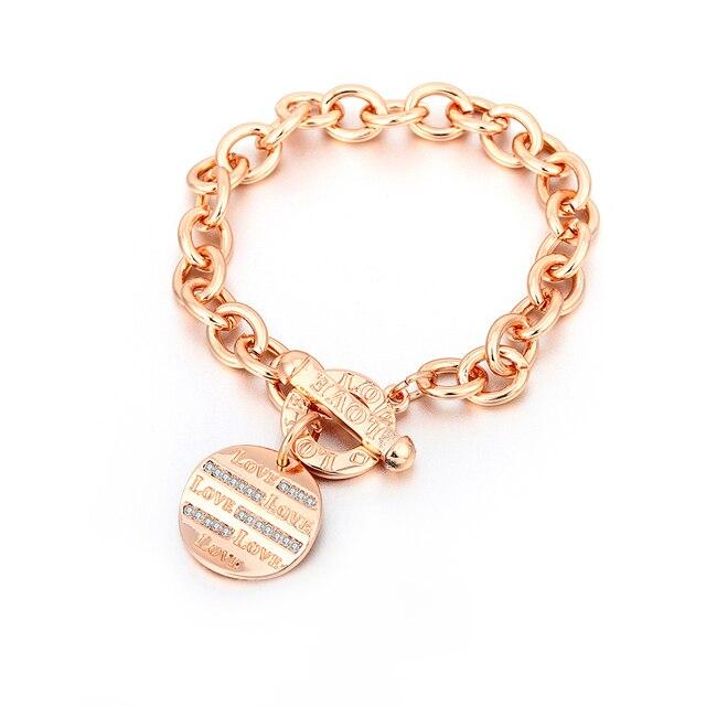 Фото золотые браслеты на запястье для женщин круглый диск с логотипом цена