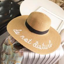 Nuevo verano gran sombrero de paja de ala ancha carta bordado playa visera sombrero  sombreros plegables de Sun para las mujeres . a41fed1f65f