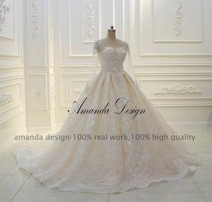Image 2 - فستان زفاف عالي الجودة بأكمام طويلة مزين باللؤلؤ الشامبانيا بتصميم أماندا