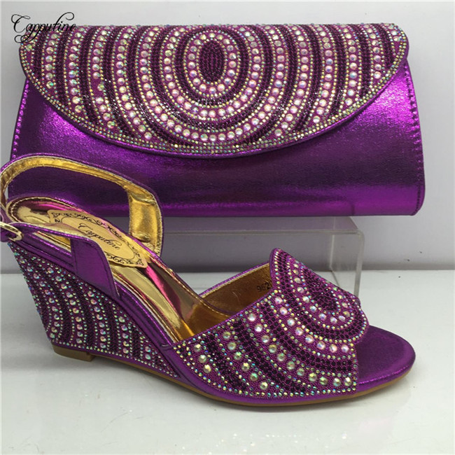 Graceful purple wedge heel pumps with purse bag African buckle design shoes and evening handbag set GY27 in purpleGraceful purple wedge heel pumps with purse bag African buckle design shoes and evening handbag set GY27 in purple