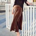 Заклепки асимметричные бархатные юбки женщин 2017 весна сексуальная элегантный длинные бархатные женщины юбка мода нерегулярные высокая талия леди юбка