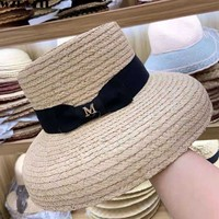 2019 Elegant crocheted raffia hat summer women beach hat ribbon bow flat ladies kentucky derby wide brim sun straw hat 56 60cm