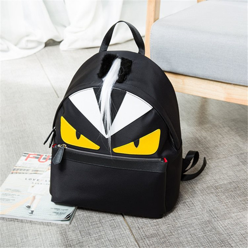 2019 nouvelle marque unisexe sac à dos personnalisé jaune et noir monstre plume décoration motif serpent sac de haute qualité