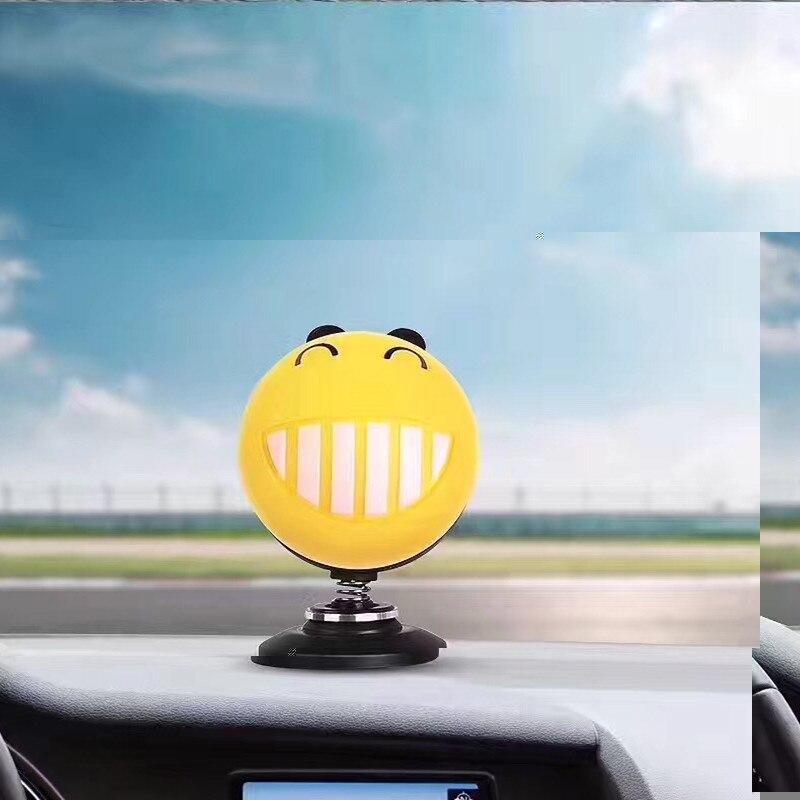 Big tooth car fragrance doll head shaking his head toy model cute car