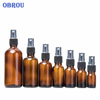 Free shipping!! one carton 5ml 10ml 15ml 20ml 30ml 50ml 100ml amber spray pump glass perfume bottles with mist sprayer cap