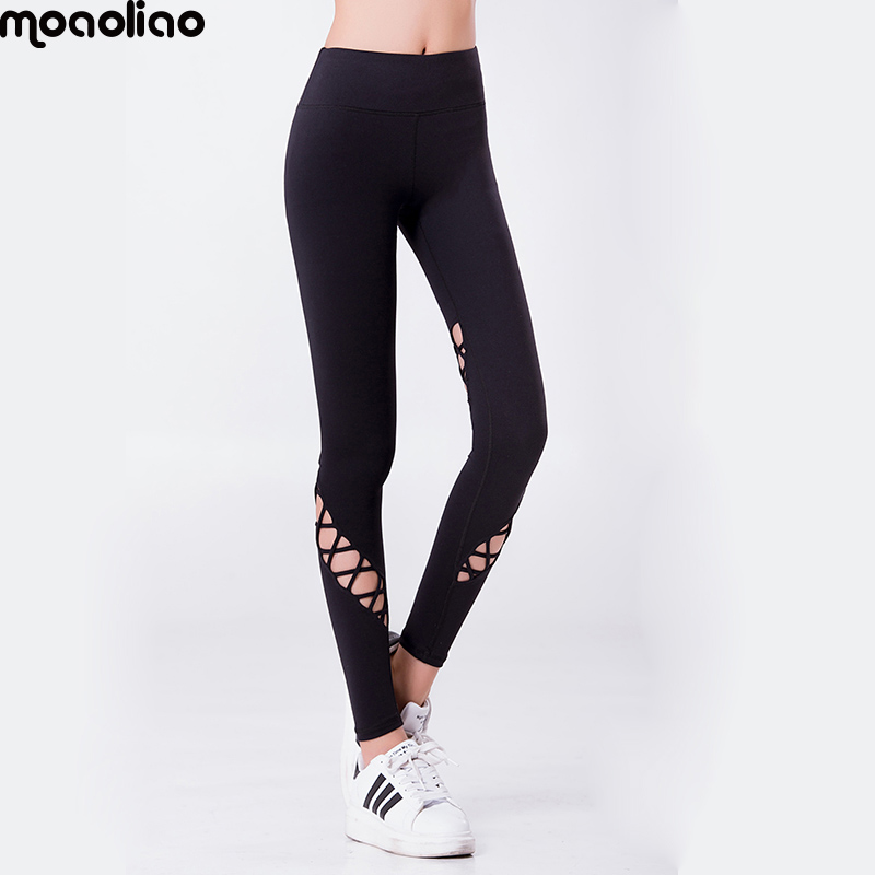 1f21c654ff moaoliao Solid Elastic Waist Yoga pants Cross Design hollow out capris Free  ShippingYoga crop high waist Women Sports leggings