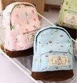 Nueva moda de kawaii tela de lona mini floral mochila mujeres niñas niños barato bolsa de la moneda monederos bolsos de embrague al por mayor