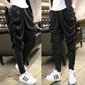 2016 de Primavera y Verano para hombre flaco pantalón Casual de la marca de Hip Hop Danza Pantalones Negros masculinos Plisada harem ocasional Pantalones