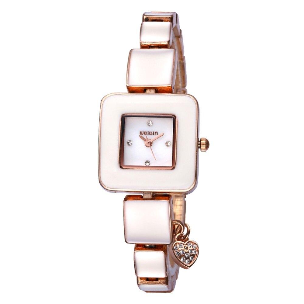 7134d9b543f6 Weiqin marca de lujo 2017 nuevas mujeres relojes de cuarzo reloj reloj damas  de acero inoxidable reloj de pulsera relogio feminino regalo de vacaciones  en ...